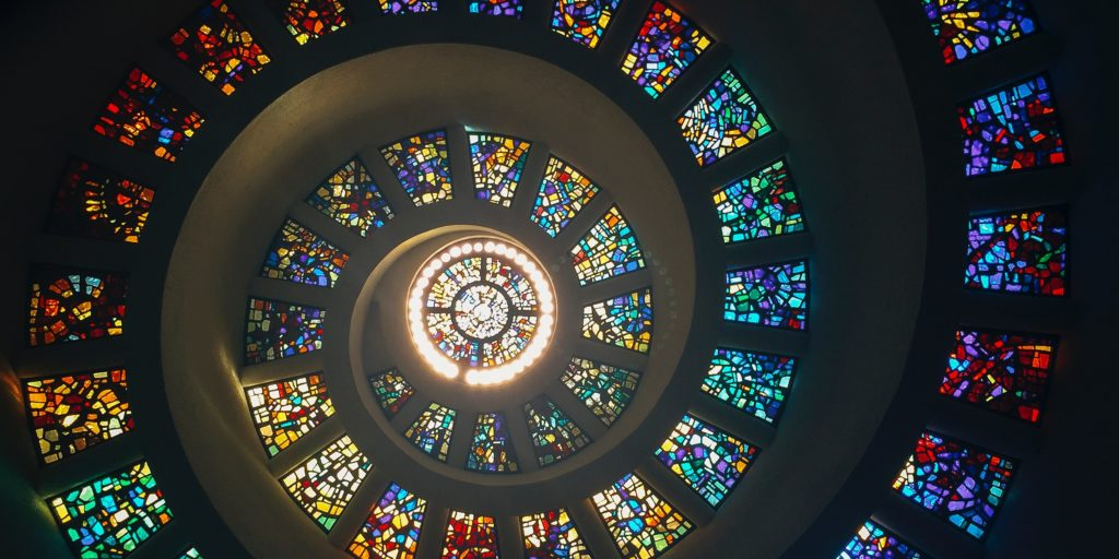 A spiralling stained glass window inside a chapel at Thanks-Giving Square in Dallas.